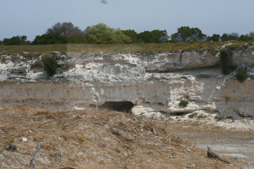 The limestone quarry with small cave to the back.