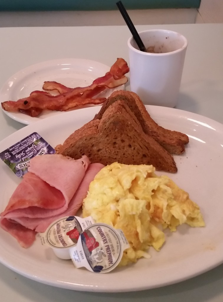 Scrambled eggs and ham with bacon on the side and whole wheat toast. The drink was hot chocolate. Grade C