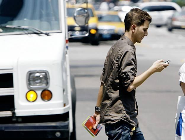 Walking and texting - a big No-no. Photo courtesy of Digitaltrends.com)