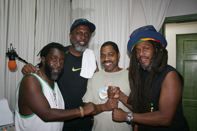 Steve in studio with band members of the group Steel Pulse