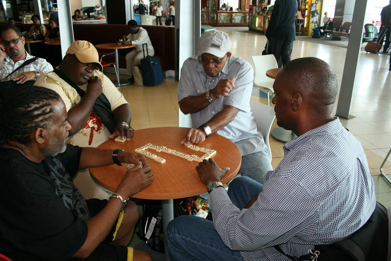 A spirited domino match while waiting for a flight