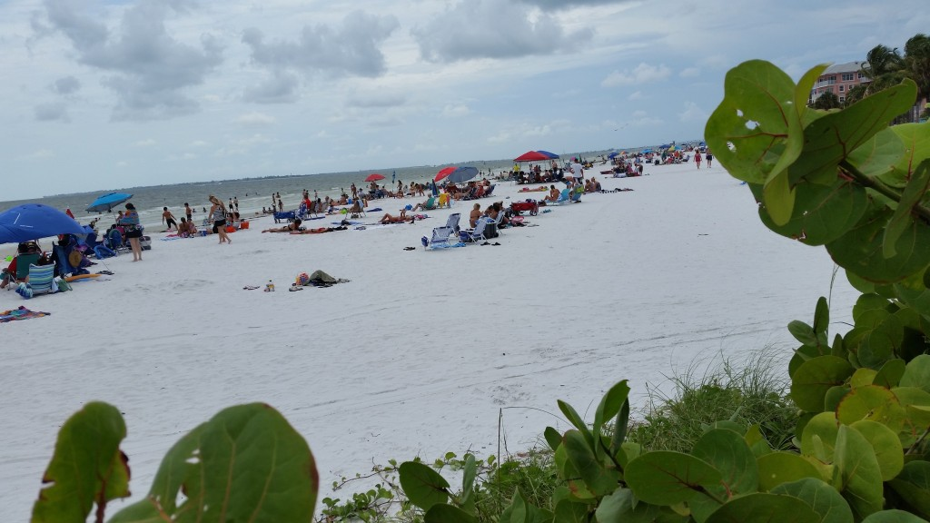 Sunbathers enjoying Fort Myers Beach