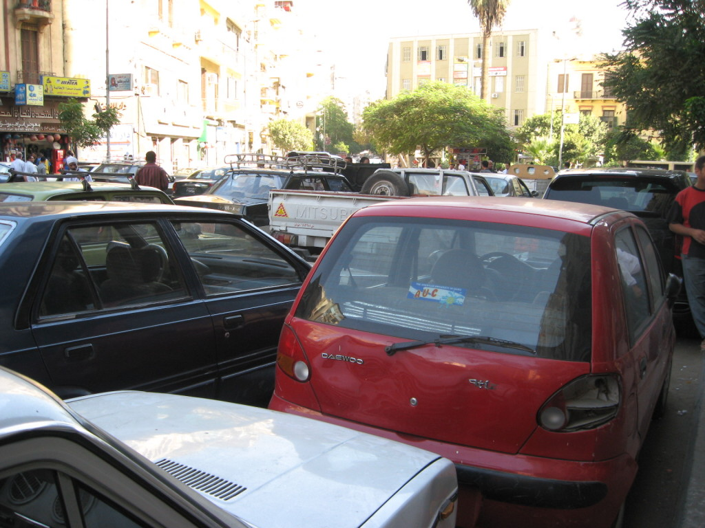 Heavily trafficked street in Cairo, filled with licensed and unlicensed taxis and buses,