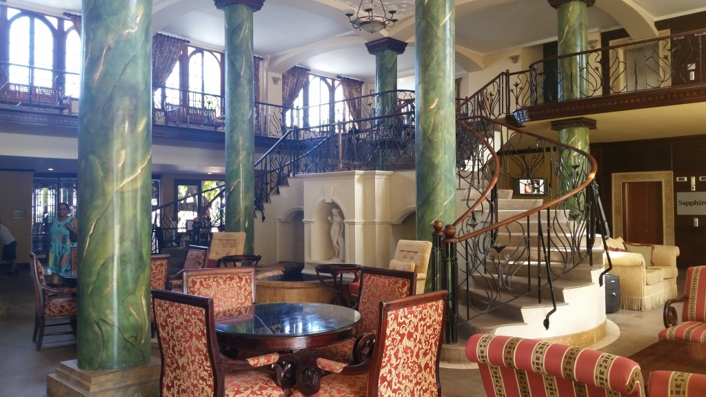 Hotel lobby at Jewels Dunn's River Resort. It has multiple entrances and exits.