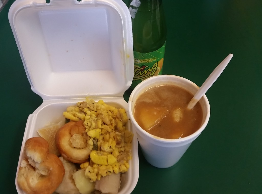 Ackee and saltfish, festival and boiled banana with red peas soup and a Ting