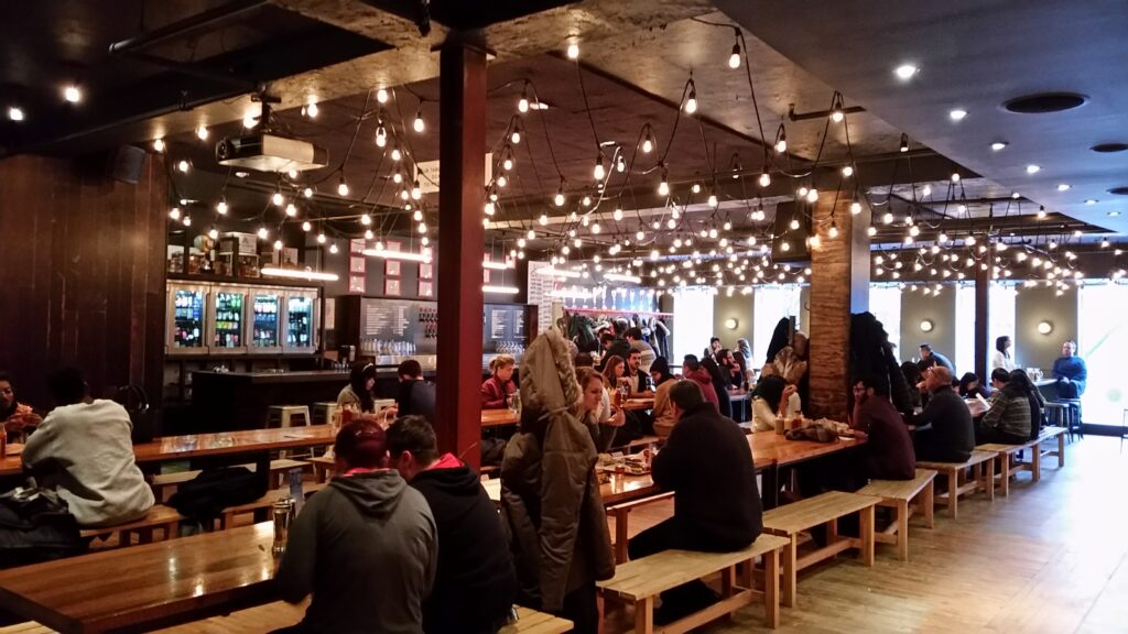 Dining area at Wvrst Beer Hall, Tornoto, Canada