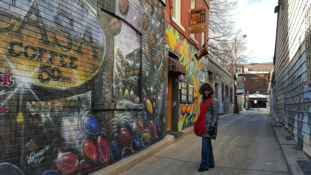 An alley in Kensington Market with walls that looked like an outdoor art gallery