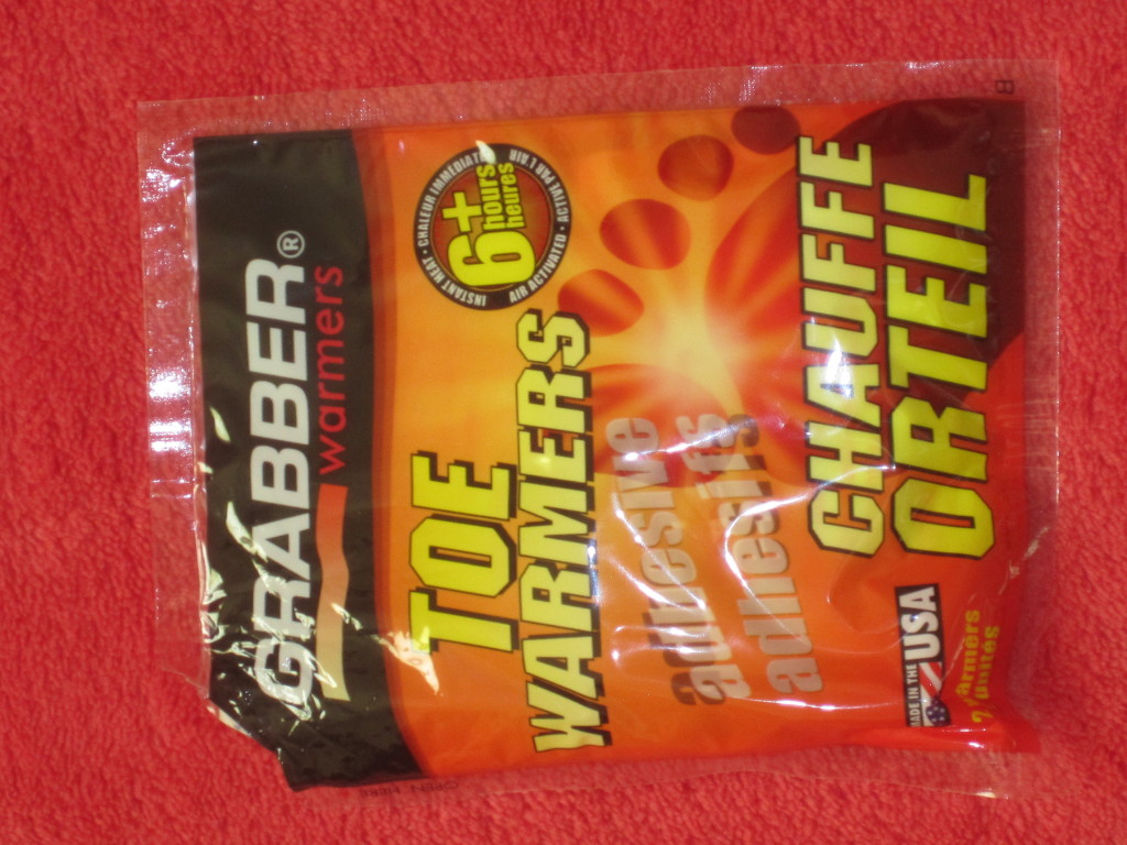 Look for the Grabber brand of toe warmers and stick them over your socks in the area below your toes.