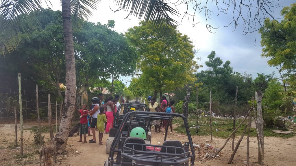 Dune buggies stop at village in La Romana Province, Dominican Republic